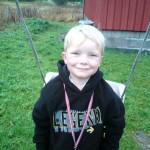 Sindre med medalje. Foto: Marte Talgø